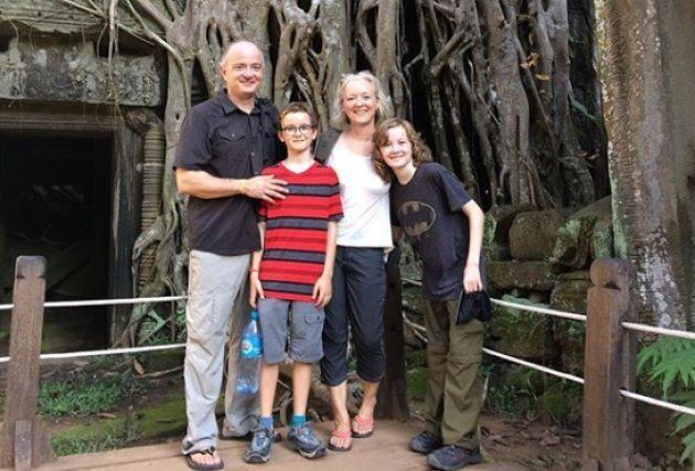 The Kistormas pose for a family photo at Ta Prohm in Cambodia.