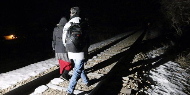 Migrants from Somalia cross into Canada illegally from the United States on Feb. 26,