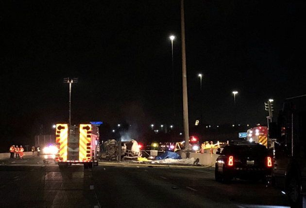 Emergency crews attend a multi-vehicle crash after an accident on highway 407 in Toronto on Oct. 31,