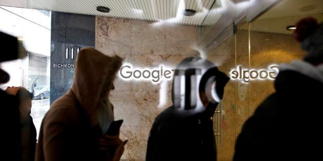 Google Canada employees return to the Google office in Toronto following a walkout Thurs. Nov.
