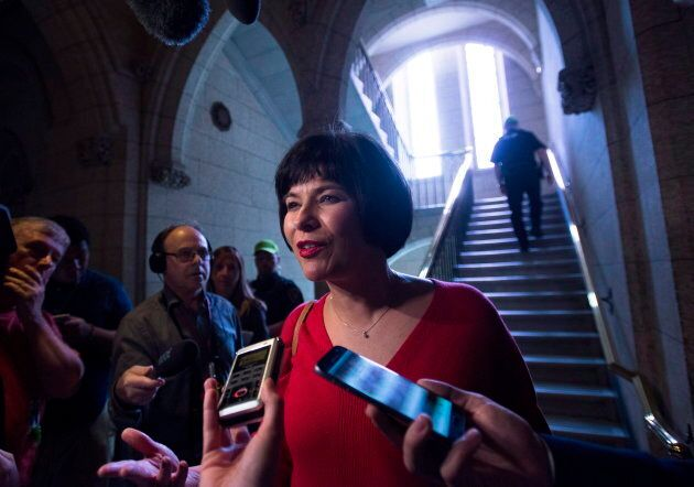 Health Minister Ginette Petitpas Taylor speaks to reporters in the foyer following question period on...