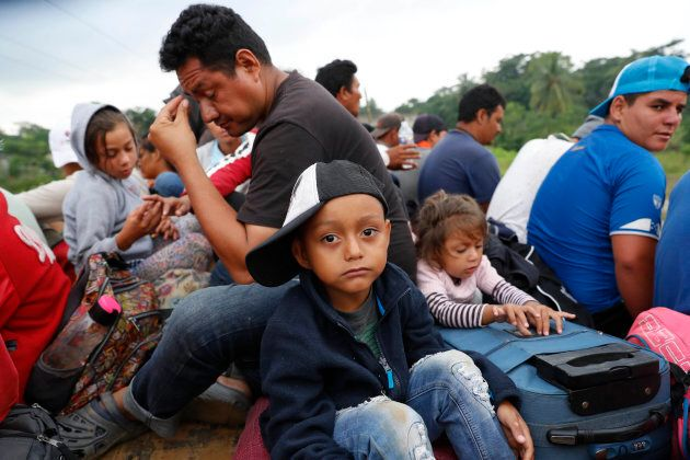 Central American migrants, part of the caravan hoping to reach the U.S. border, get a ride on the bed...