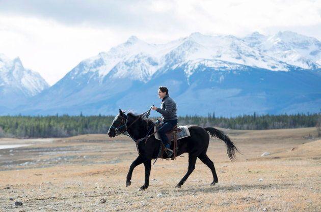 Prime Minister Justin Trudeau rides horseback near Chilko Lake, B.C. on