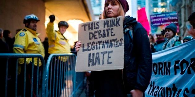 Chanting protesters delay debate involving ex-Trump strategist Steve