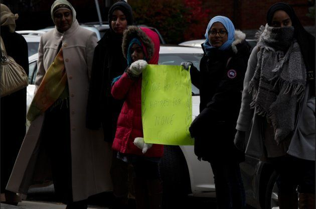Young members of the Islamic Institute of Toronto offer support at Beth Sholom in York, Ont. on Nov. 3, 2018.