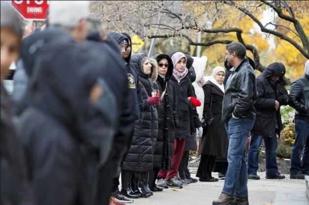 Demonstrators of various faiths, including members of the Islamic Institute of Toronto, gather at Beth...