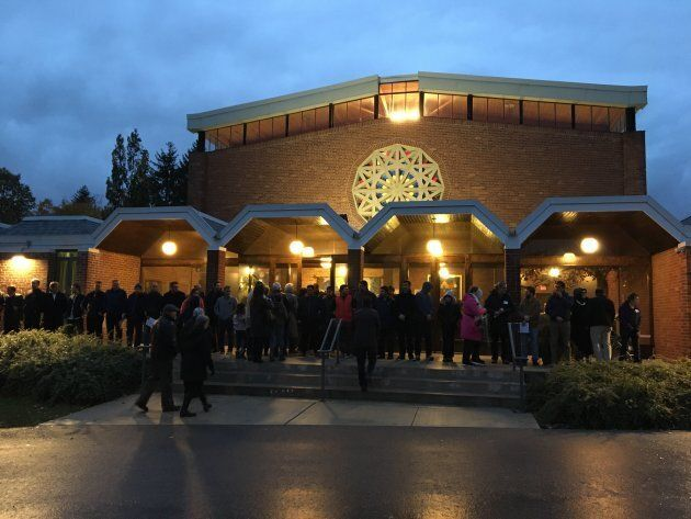 Members of Embrace Islamic Society form a Ring of Peace around Temple Emanuel in North York, Ont. on Nov. 2, 2018.