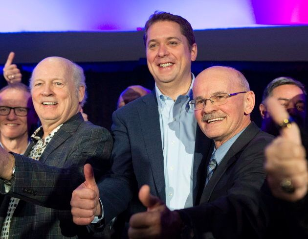 Scheer poses with former Bloc leader Michel Gauthier and Richard Lehoux on Nov. 3,