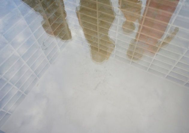 The book burning memorial at Bebelplatz in Berlin takes the form of empty white bookshelves beneath a sheet of glass.