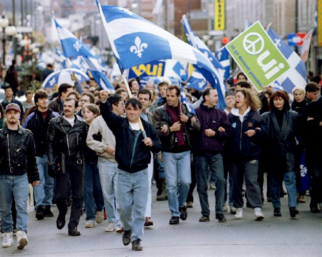 """Quebecers on the """"yes"""" side of Quebec's 1995 referendum march in Montreal, Que., on Oct. 29."""