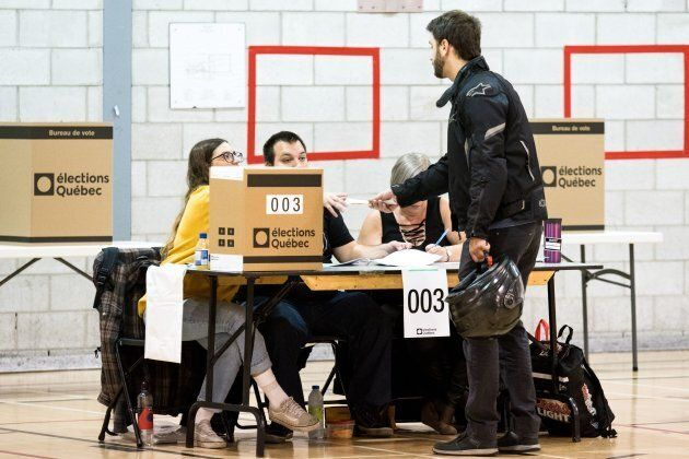 A man casts his ballot at a polling station in the provincial elections on October 1, 2018 in Montreal,...