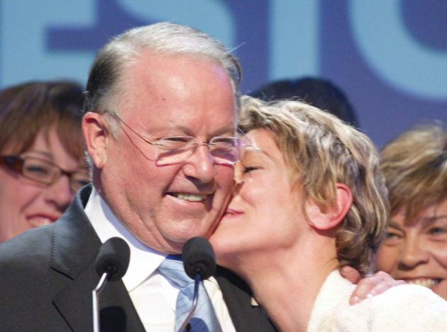 Bernard receives a kiss from his girlfriend Chantal Renaud before giving his concession speech to his...