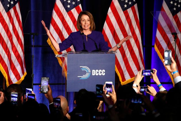House Minority Leader Nancy Pelosi of Calif., smiles as she is cheered by a crowd of Democratic supporters...