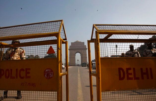 Indian policemen stand guard near India Gate in New Delhi, India, Jan. 8, 2013. The Mounties say they've...