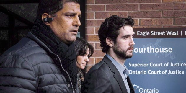 Marco Muzzo, right, leaves the Newmarket courthouse surrounded by family, on Feb. 4,