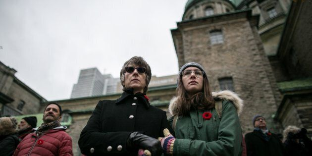 Canadians watch military parades during Remembrance Day ceremonies in Montreal,
