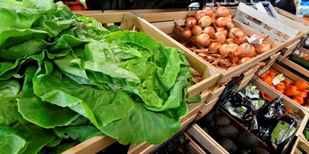 Organic lettuce and onions on sale at an organic supermarket in Saintes, western France, on October 23,...