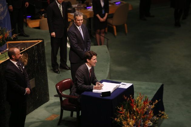Prime Minister Justin Trudeau signing the Paris