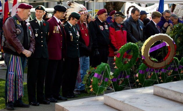 Veterans gather at the Victory Square Cenotaph for a National Aboriginal Veterans Day ceremony in Vancouver,...