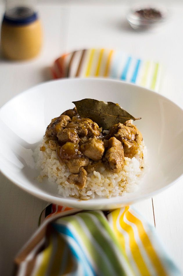 Chicken and pork adobo over rice.