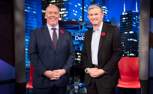 B.C. Premier John Horgan (L) and Liberal Leader Andrew Wilkinson smile for the cameras at a debate on...