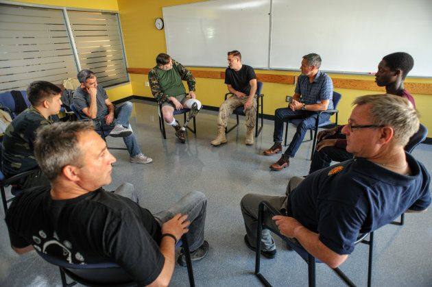 Graduates of the Veterans Transition Program illustrate what a group session commonly looks like.