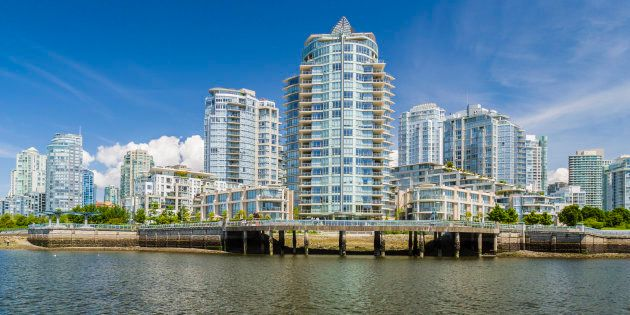 Condo towers overlooking Vancouver's False Creek. Condo prices per square foot in the city centre have soared 40 per cent over the past year, according to a survey from Century 21 Canada.