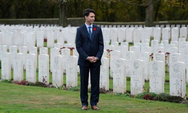 Trudeau stands among the military gravestones as he visits the Canadian Cemetery No. 2 on Nov. 10,