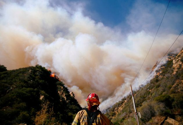 Firefighters battle the Woolsey Fire as it continues to burn in Malibu, Calif., Nov. 11,