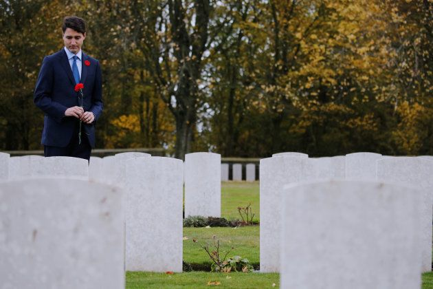 Canadian Prime Minister Justin Trudeau marks his respect in Canadian cemetery No 2 at Canadian National...