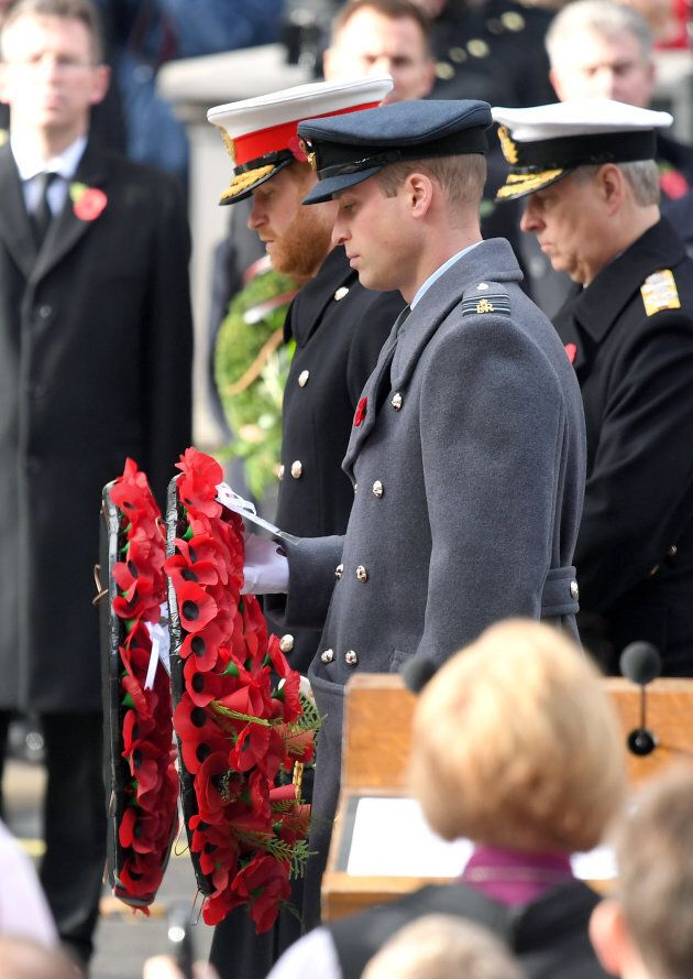 Prince Harry and Prince William lay a wreath during the annual Remembrance Sunday memorial at The