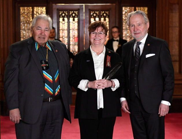 Senator Yvonne Boyer is sworn in as a senator with Murray Sinclair, left, and Peter Harder on March 20, 2018.