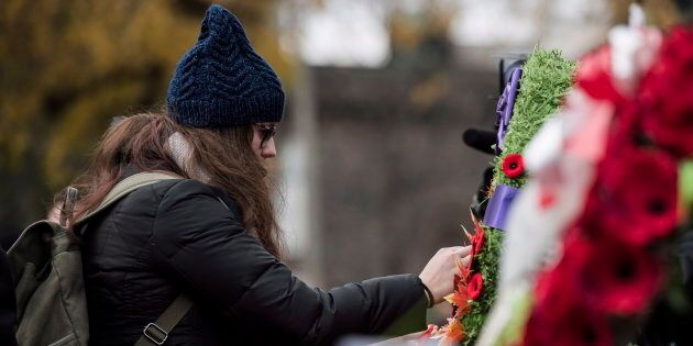 A woman pays her respects at a Remembrance Day