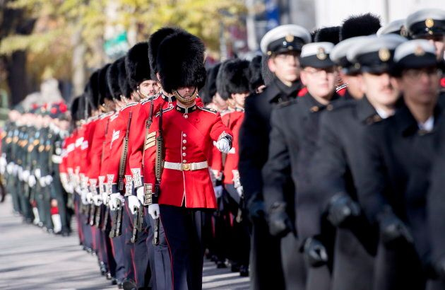 Members of the Armed Forces participate in a Remembrance Day ceremony in