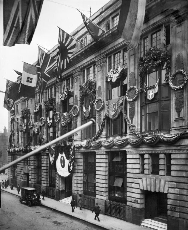 Decorations celebrating the end of the First World War on the front elevation of the Comptoir National...
