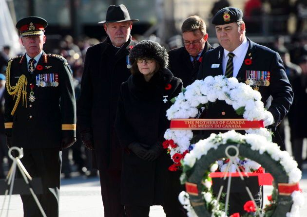 National Silver Cross mother Anita Cenerini prepares to lay down a wreath on