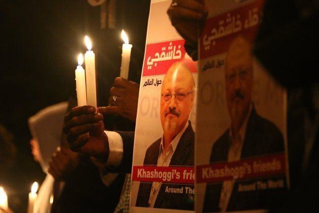 Activists, protesting the killing of Saudi journalist Jamal Khashoggi, hold a candlelight vigil outside...