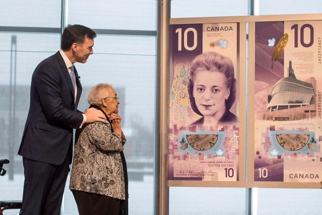 Wanda Robson, second from left, sister of Viola Desmond, admires the new $10 banknote featuring Desmond,...