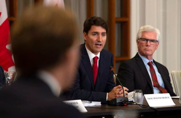 Canadian International Trade Diversification Minister Jim Carr (right) looks on as Prime Minister Justin...