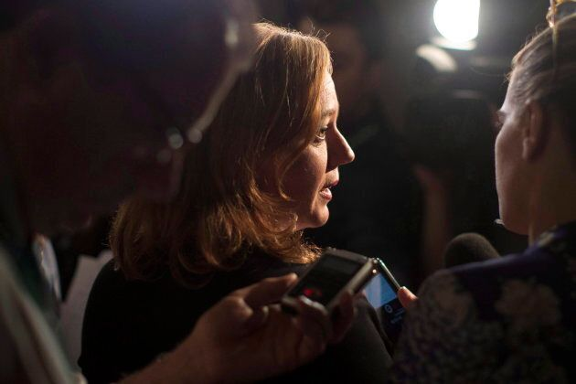 Ontario Minister Lisa Macleod talks with reporters at the Ontario legislature in Toronto on Aug. 2, 2018.
