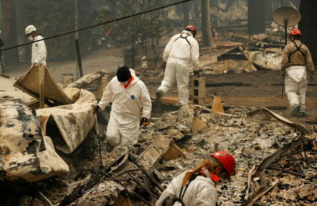Search and rescue workers search for human remains at a Paradise, Calif. trailer park on Nov. 13,
