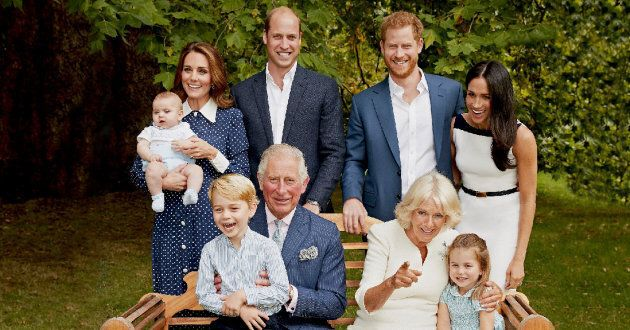 Prince Charles appears to be soaking up grandpa life in this new family portrait.