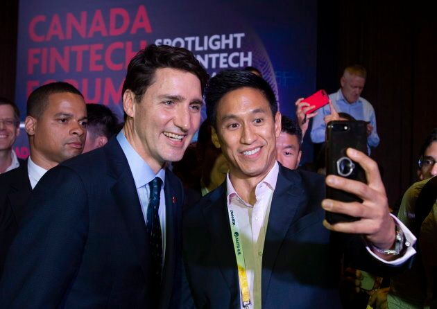Prime Minister Justin Trudeau poses for photos following a speech at a conference in Singapore on Nov....