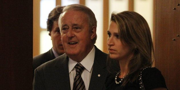 Former prime minister Brian Mulroney, centre, with his son Mark, left, and daughter Caroline arrives...