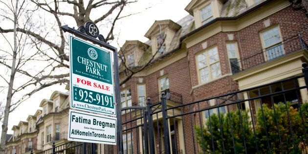 A for sale sign outside a rowhouse in Toronto. After showing signs of a rebound over the spring and summer...