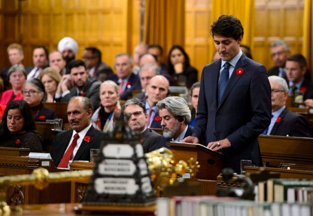 Canadian Prime Minister Justin Trudeau stands to deliver a formal apology on behalf of his nation for  the MS St. Louis affair in 1939 in the House of Commons in Ottawa on Nov. 7, 2018.