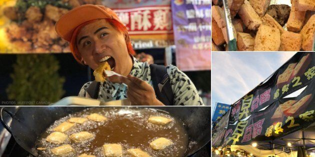 Adam Chen eats stinky tofu at the Waterfront Night Market in Toronto.