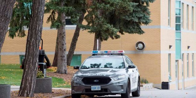 A police car is parked outside St. Michael's College School in Toronto on Nov. 15,