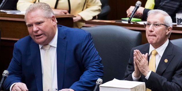 Ontario Premier Doug Ford and Finance Minister Vic Fedeli sit in the legislature before tabling the Fall...