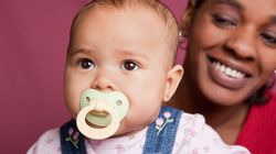 Sucking On Your Baby's Pacifier Could Pass Them Health Benefits:
